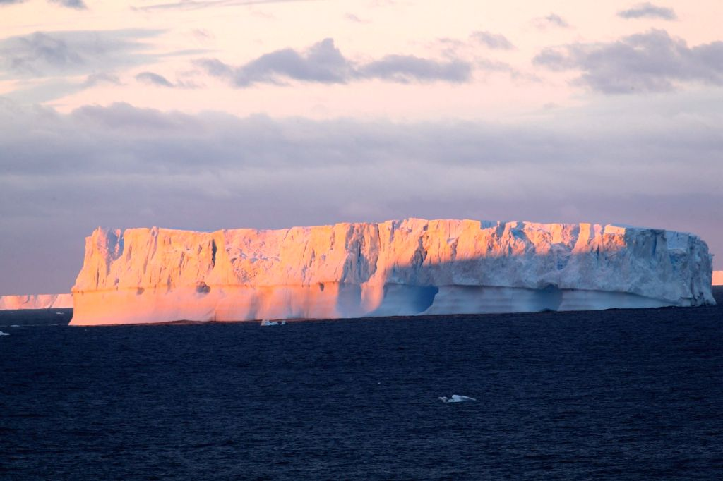 ABOARD XUELONG, Feb. 18, 2019 - Photo taken on Feb. 13, 2019 shows the edge of the Antarctic ice sheet and an iceberg on the sea near the Zhongshan Station, a Chinese research base in Antarctica. The ...
