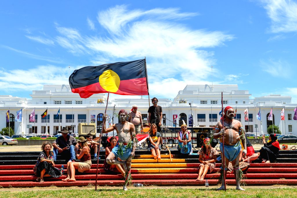 Aboriginal Australians hold a ceremony to greet the People's Climate March in front of the Old Parliament House in Canberra, Australia, Nov. 29, 2015. Thousands of ...