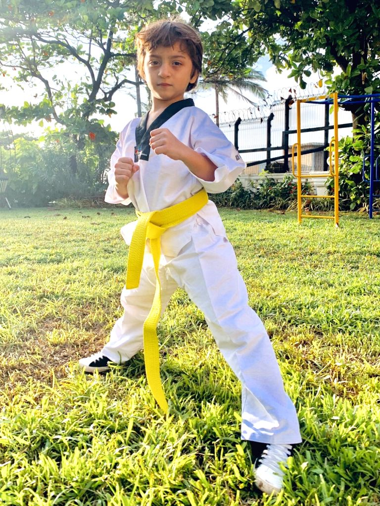 AbRam Khan, son of actor Shah Rukh Khan joins the family tradition of Taekwondo and is now a yellow belt in the sport. Shah Rukh took to Twitter to share a photograph of his three children in ... - Shah Rukh Khan