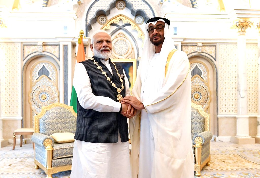 "Abu Dhabi: Abu Dhabi Crown Prince and Deputy Supreme Commander of the UAE Armed Forces Mohamed bin Zayed Al Nahyan confers highest civilian honour, the ""Order of Zayed"" on Prime Minister Narendra Modi at the Presidential Palace in Abu Dhabi on Aug 24 - Narendra Modi"