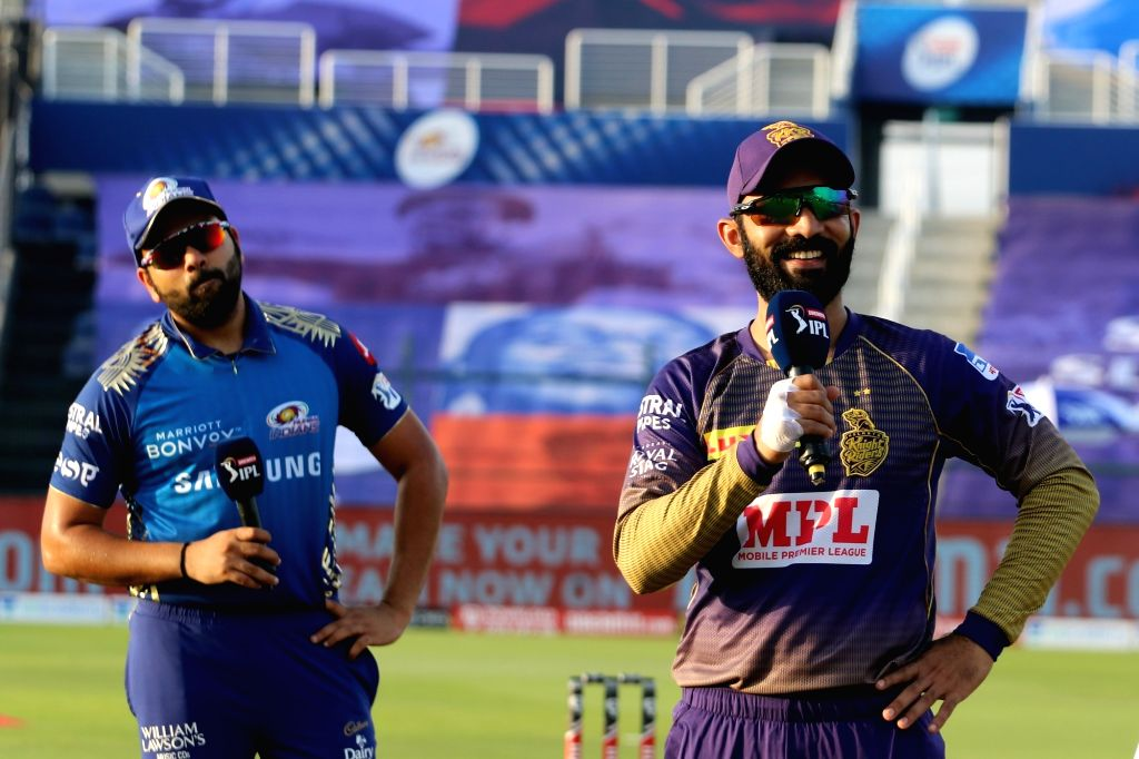 Abu Dhabi: Dinesh Karthik captain of Kolkata Knight Riders and Rohit Sharma captain of Mumbai Indians during the toss of the match 5 of season 13 of the Dream 11 Indian Premier League (IPL) between the Kolkata Knight Riders and the Mumbai Indians hel - Rohit Sharma