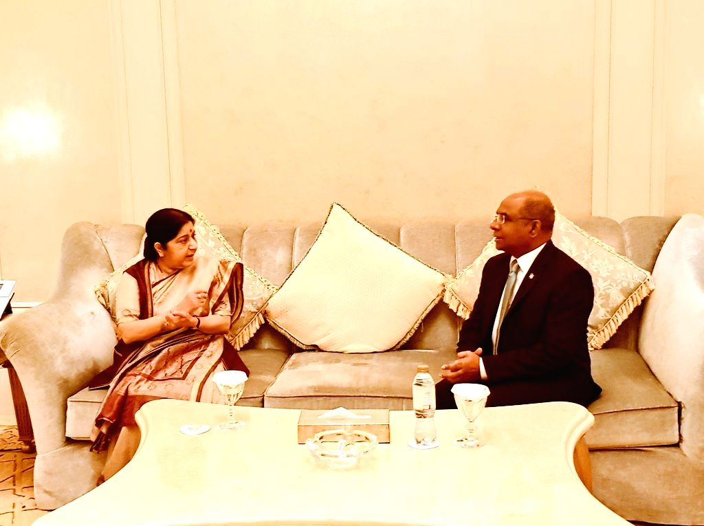 Abu Dhabi: External Affairs Minister Sushma Swaraj meets Maldives Foreign Minister Abdulla Shahid on the sidelines of the 46th Foreign Ministers Meeting of Organisation of Islamic Cooperation (OIC), ... - Sushma Swaraj and Meeting