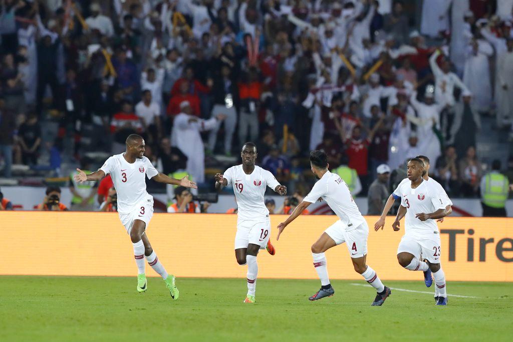 ABU DHABI, Feb. 1, 2019 - Almoez Ali (2nd L) of Qatar celebrates scoring during the final match between Japan and Qatar at the 2019 AFC Asian Cup in Abu Dhabi, the United Arab Emirates (UAE), Feb. 1, ...