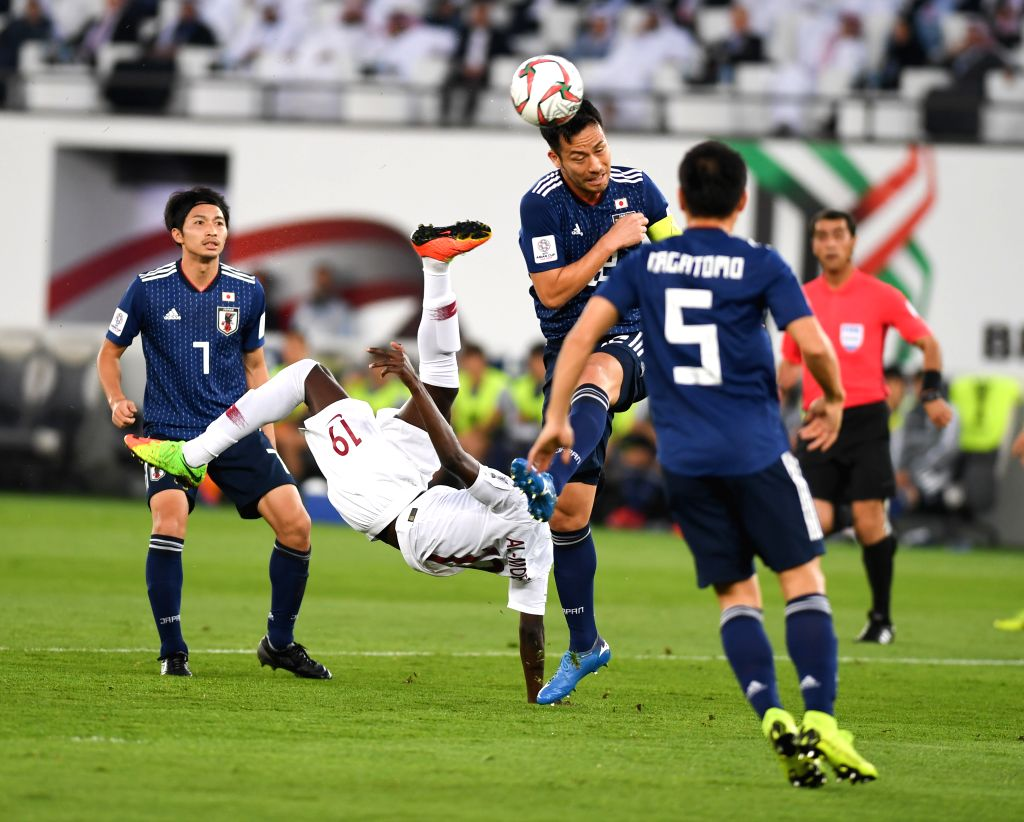 ABU DHABI, Feb. 1, 2019 - Almoez Ali (2nd L) of Qatar shoots to score during the final match between Japan and Qatar at the 2019 AFC Asian Cup in Abu Dhabi, the United Arab Emirates (UAE), Feb. 1, ...