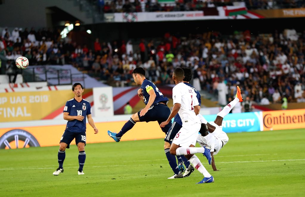 ABU DHABI, Feb. 1, 2019 - Almoez Ali (R) of Qatar shoots to score during the final match between Japan and Qatar at the 2019 AFC Asian Cup in Abu Dhabi, the United Arab Emirates (UAE), Feb. 1, 2019.
