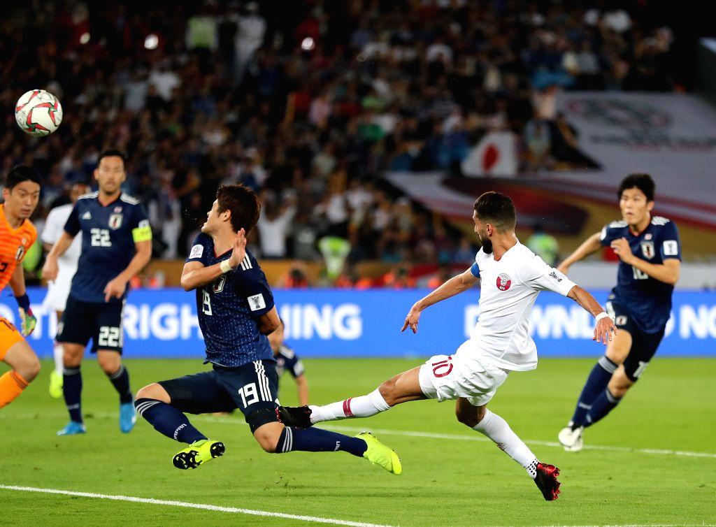 ABU DHABI, Feb. 1, 2019 - Hasan Al Haydos (2nd R) of Qatar shoots during the final match between Japan and Qatar at the 2019 AFC Asian Cup in Abu Dhabi, the United Arab Emirates (UAE), Feb. 1, 2019.