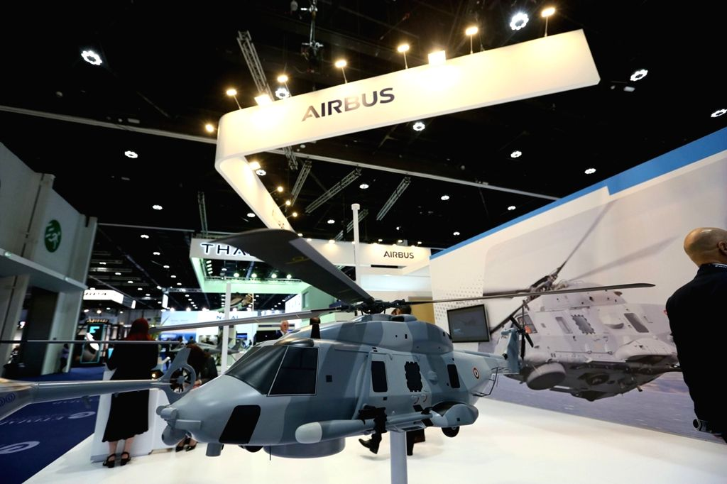 ABU DHABI, Feb. 18, 2019 - A helicopter model is displayed at an exhibition area of the International Defense Exhibition and Conference in Abu Dhabi, the United Arab Emirates, Feb. 17, 2019. The ...