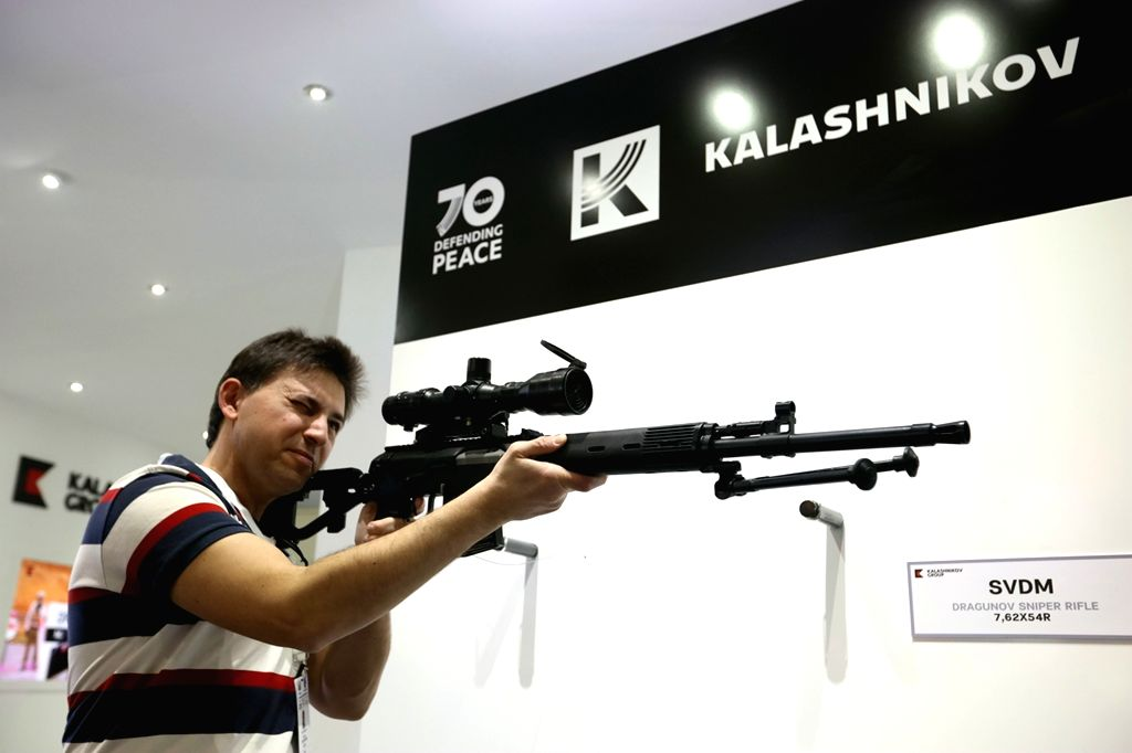 ABU DHABI, Feb. 22, 2019 - A visitor tries a rifle displayed at the International Defense Exhibition and Conference in Abu Dhabi, the United Arab Emirates, Feb. 21, 2019. The United Arab Emirates ...