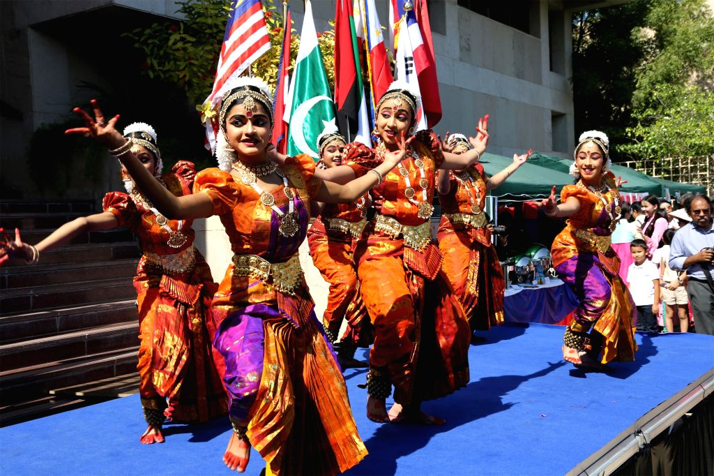 Indian dancers perform on the stage during an Asian food festival and charity bazaar at the Embassy of India in Abu Dhabi, Feb. 7, 2015. All Asian diplomatic ...