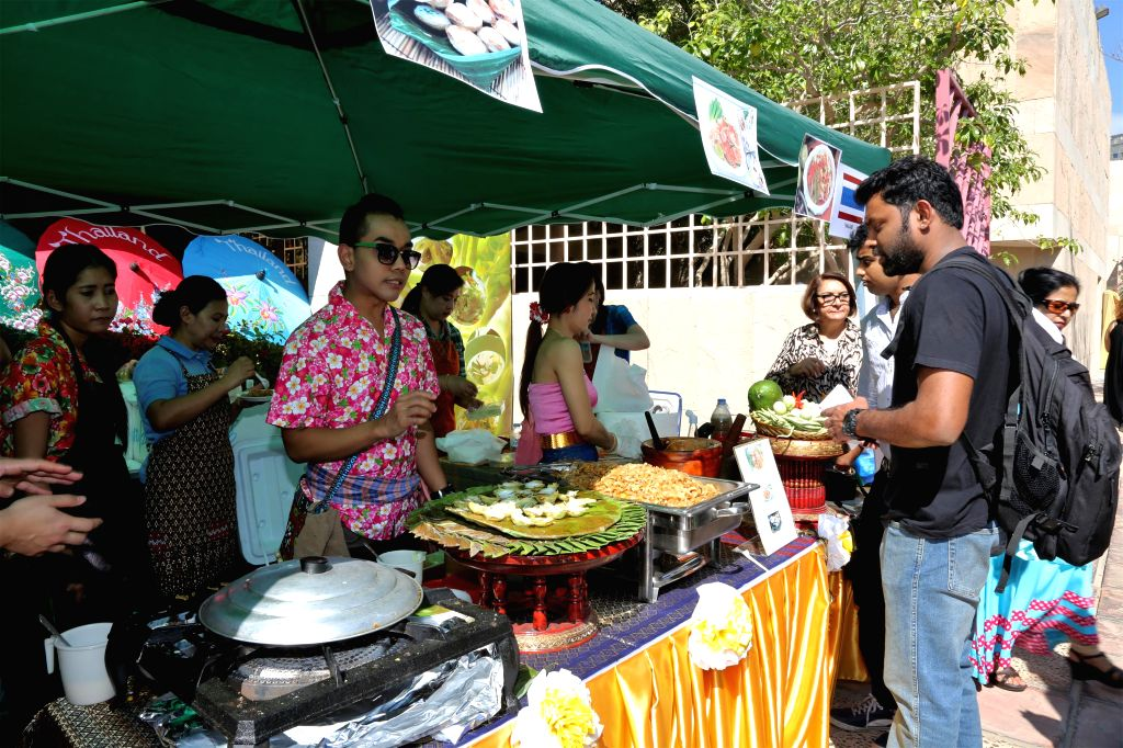 Visitors try thai food during an Asian food festival and charity bazaar at the Embassy of India in Abu Dhabi, Feb. 7, 2015. All Asian diplomatic missions have set ...