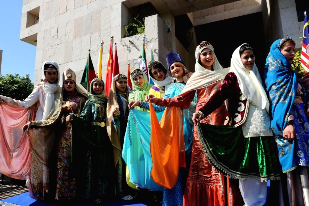 Women from central Asian diplomatic missions show their ethnic costumes during an Asian food festival and charity bazaar at the Embassy of India in Abu Dhabi, Feb. ..