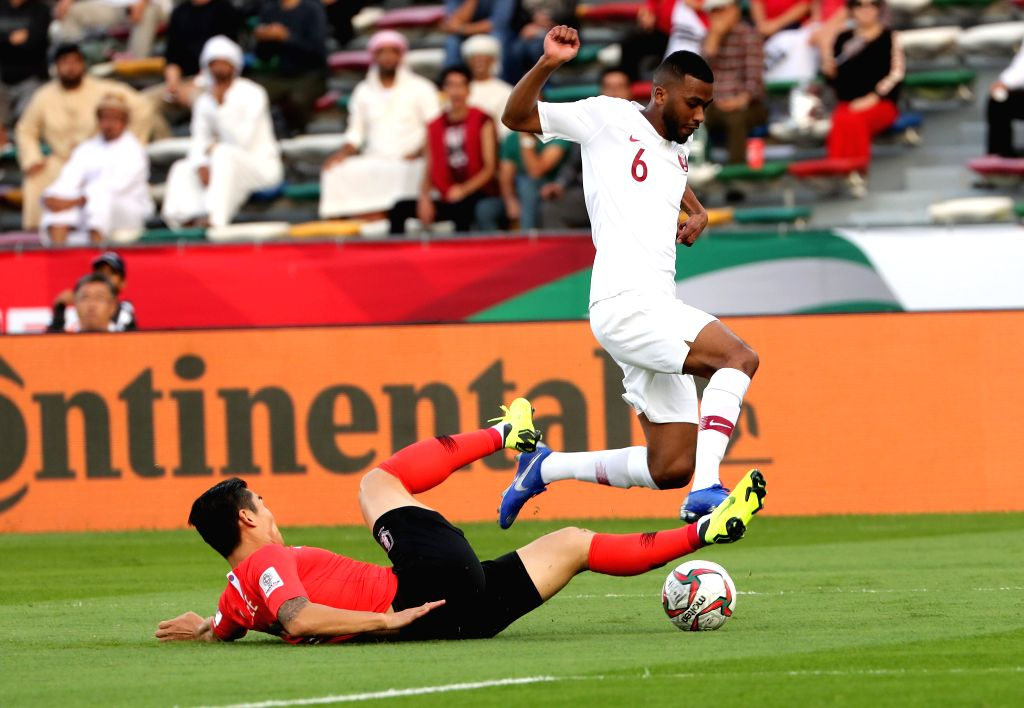 ABU DHABI, Jan. 25, 2019 - Abdelaziz Hatim (top) of Qatar competes during the quarterfinal match between South Korea and Qatar at the 2019 AFC Asian Cup in Abu Dhabi, the United Arab Emirates (UAE), ...