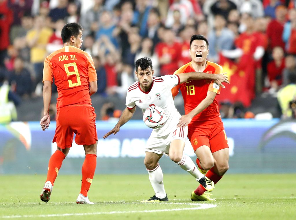ABU DHABI, Jan. 25, 2019 - Gao Lin (R) of China vies with Omid Ebrahimi (C) of Iran during the 2019 AFC Asian Cup quarterfinal match between China and Iran in Abu Dhabi, the United Arab Emirates, on ...