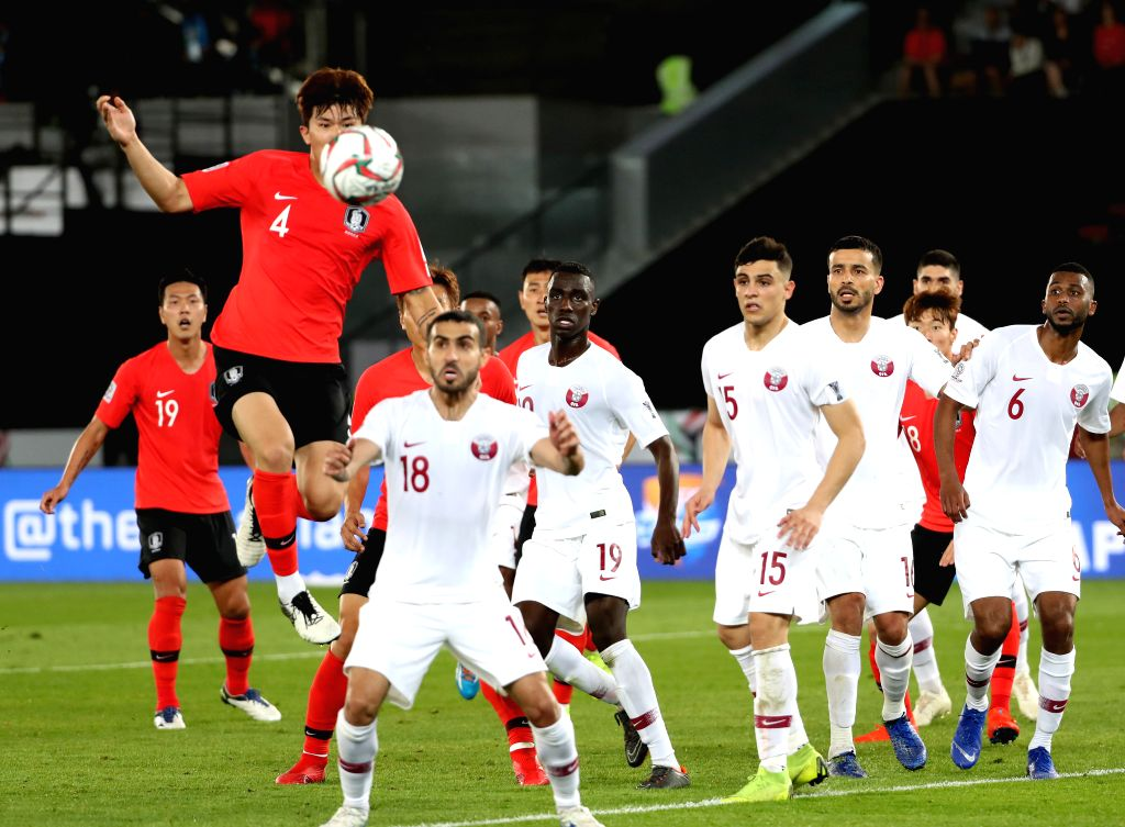ABU DHABI, Jan. 25, 2019 - South Korea's Kim Minjae (top) vies for ball during the quarterfinal match between South Korea and Qatar at the 2019 AFC Asian Cup in Abu Dhabi, the United Arab Emirates ...