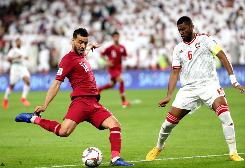 ABU DHABI, Jan. 29, 2019 - Qatar's Boualem Khoukhi (L) shoots during the semifinal match between the United Arab Emirates and Qatar at the 2019 AFC Asian Cup in Abu Dhabi, the United Arab Emirates ...