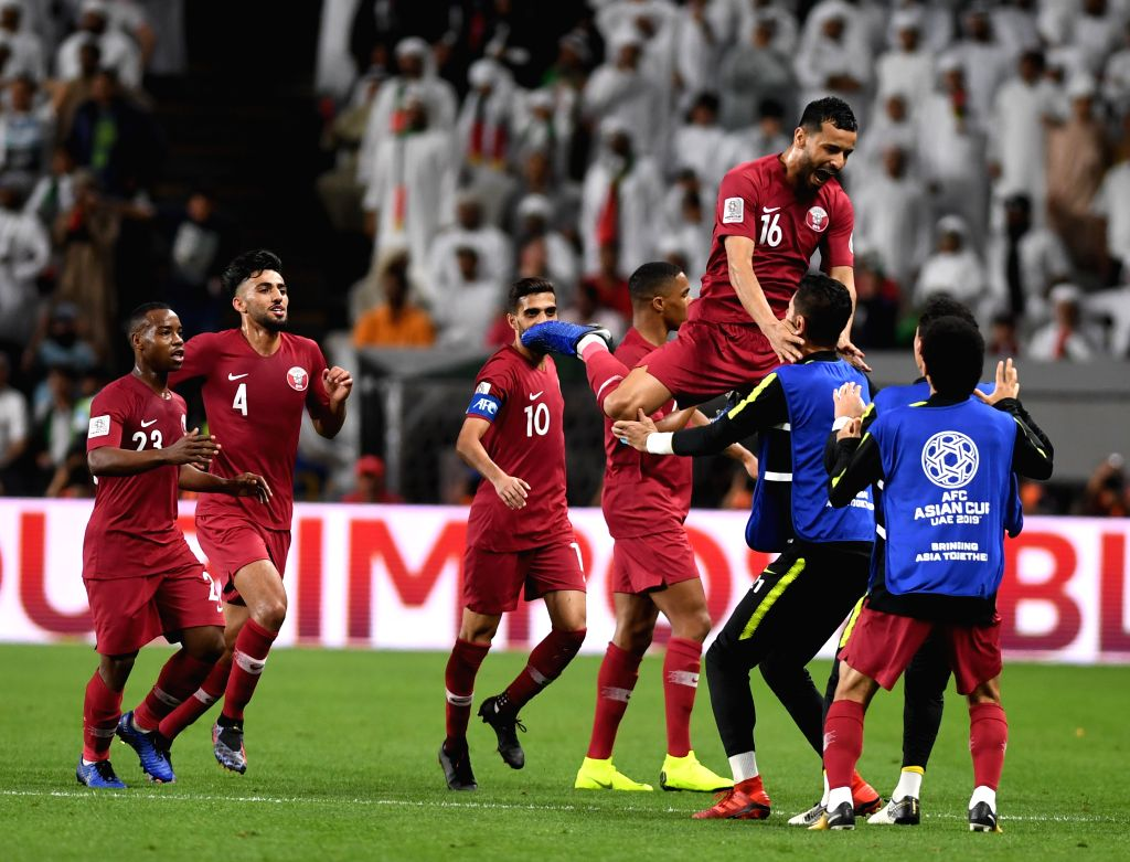 ABU DHABI, Jan. 29, 2019 - Qatar's Boualem Khoukhi (top) celebrates scoring with teamates during the semifinal match between the United Arab Emirates and Qatar at the 2019 AFC Asian Cup in Abu Dhabi, ...