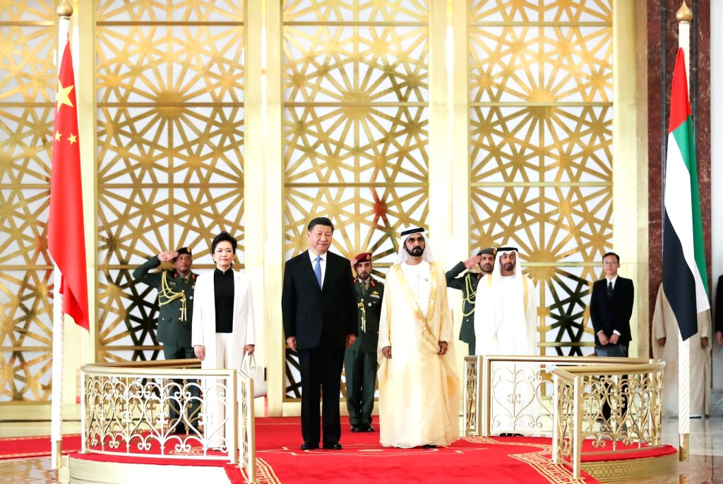 ABU DHABI, July 19, 2018 - Chinese President Xi Jinping, his wife Peng Liyuan and the United Arab Emirates (UAE) Vice President and Prime Minister Sheikh Mohammed bin Rashid Al Maktoum are seen on a ... - Sheikh Mohammed