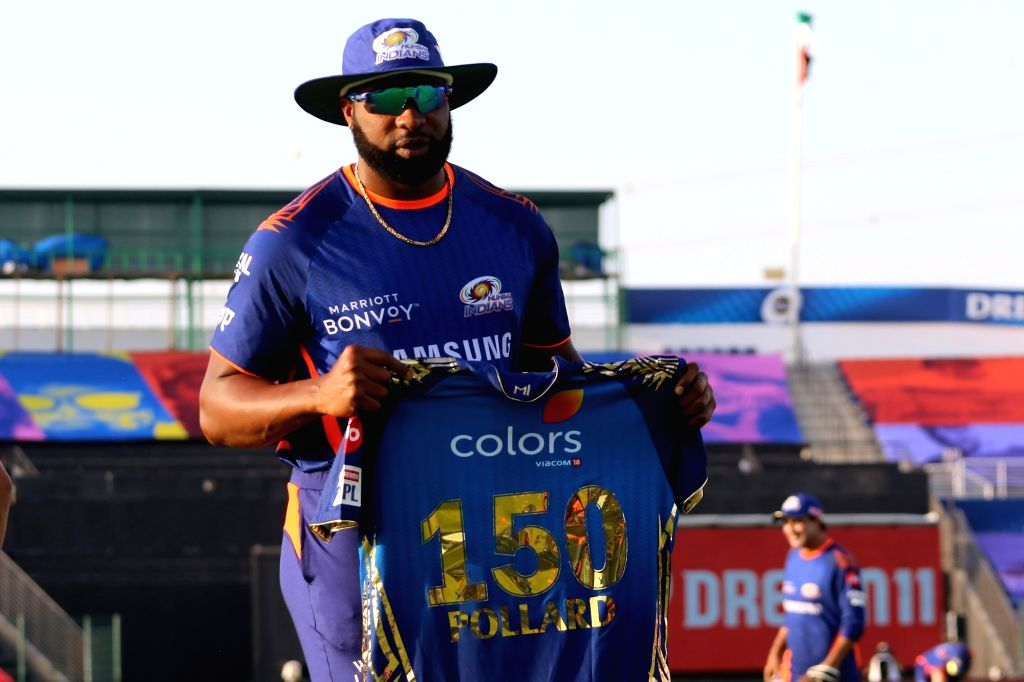 Abu Dhabi: Kieron Pollard of Mumbai Indians pose for a picture as he receives a t-shirt for playing his 150 match during match 5 of season 13 of the Dream 11 Indian Premier League (IPL) between the Kolkata Knight Riders and the Mumbai Indians held at