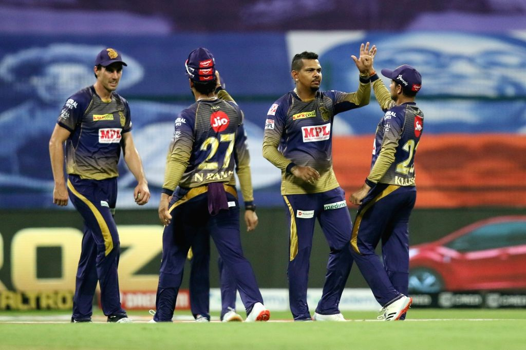 Abu Dhabi: Kolkata Knight Riders players celebrates the wicket of Saurabh Tiwary of Mumbai Indians during match 5 of season 13 of the Dream 11 Indian Premier League (IPL) between the Kolkata Knight ...