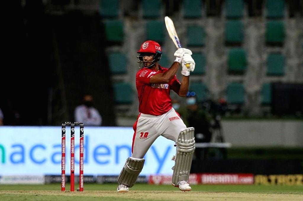 Abu Dhabi: Mayank Agarwal of Kings XI Punjab plays a shot during match 13 of season 13 of the Indian Premier League (IPL) between the Kings XI Punjab and the Mumbai Indians at the Sheikh Zayed ...