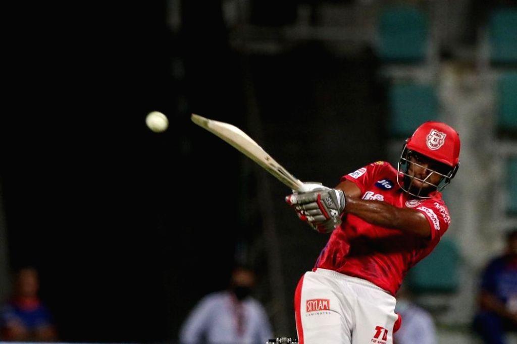 Abu Dhabi: Nicholas Pooran of Kings XI Punjab plays a shot during match 13 of season 13 of the Indian Premier League (IPL) between the Kings XI Punjab and the Mumbai Indians at the Sheikh Zayed ...