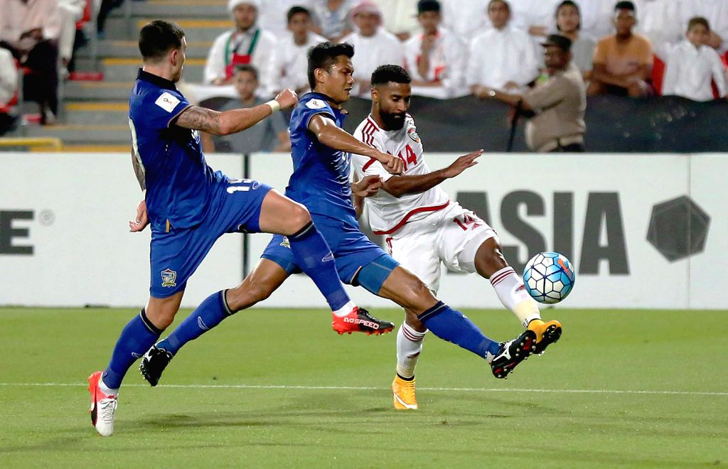 ABU DHABI, Oct. 7, 2016 - UAE's Abdelaziz Sanqour (R) competes during the World Cup 2018 football qualification match between United Arab Emirates and Thailand at the Mohammed Bin Zayed Stadium in ...