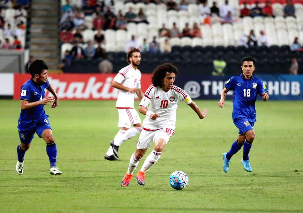 ABU DHABI, Oct. 7, 2016 - UAE's Omar Abdulrahman(2nd, R) competes during the World Cup 2018 football qualification match between United Arab Emirates and Thailand at the Mohammed Bin Zayed Stadium in ...