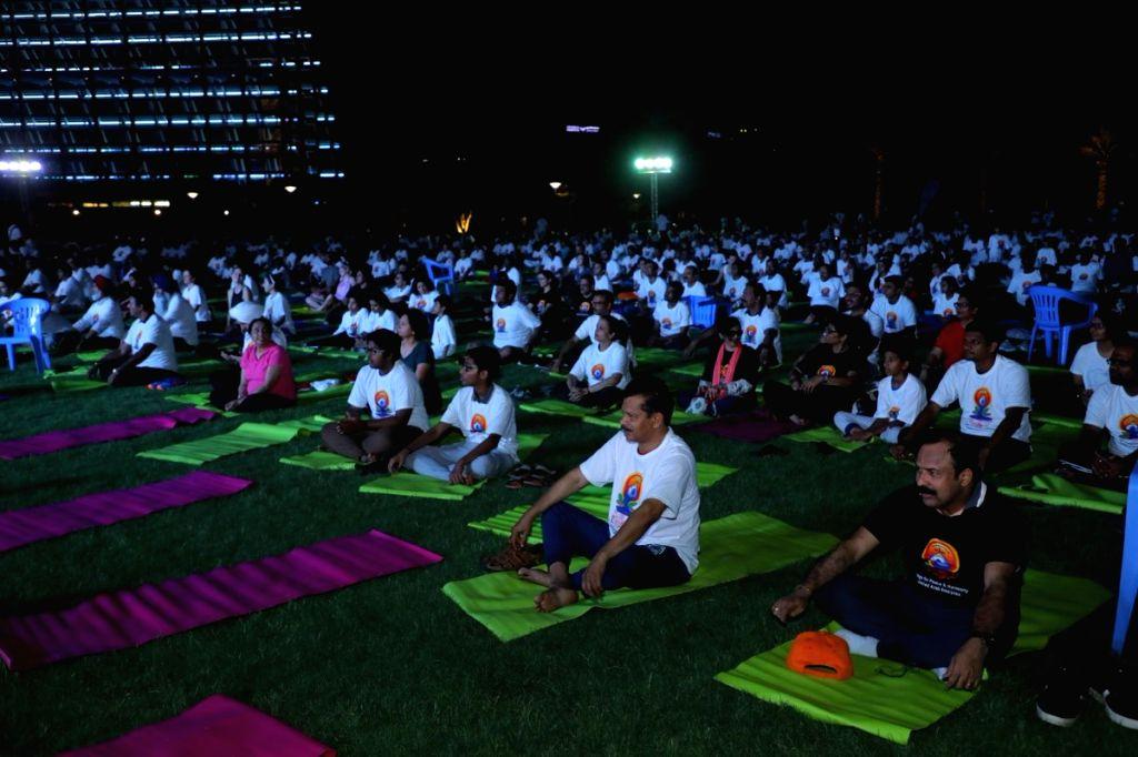 Abu Dhabi: People practice yoga asanas - postures on the 5th International Yoga Day at the Umm Al Emarat Park in Abu Dhabi on June 21, 2019. (Photo Credit: Twitter/@IndembAbuDhabi)