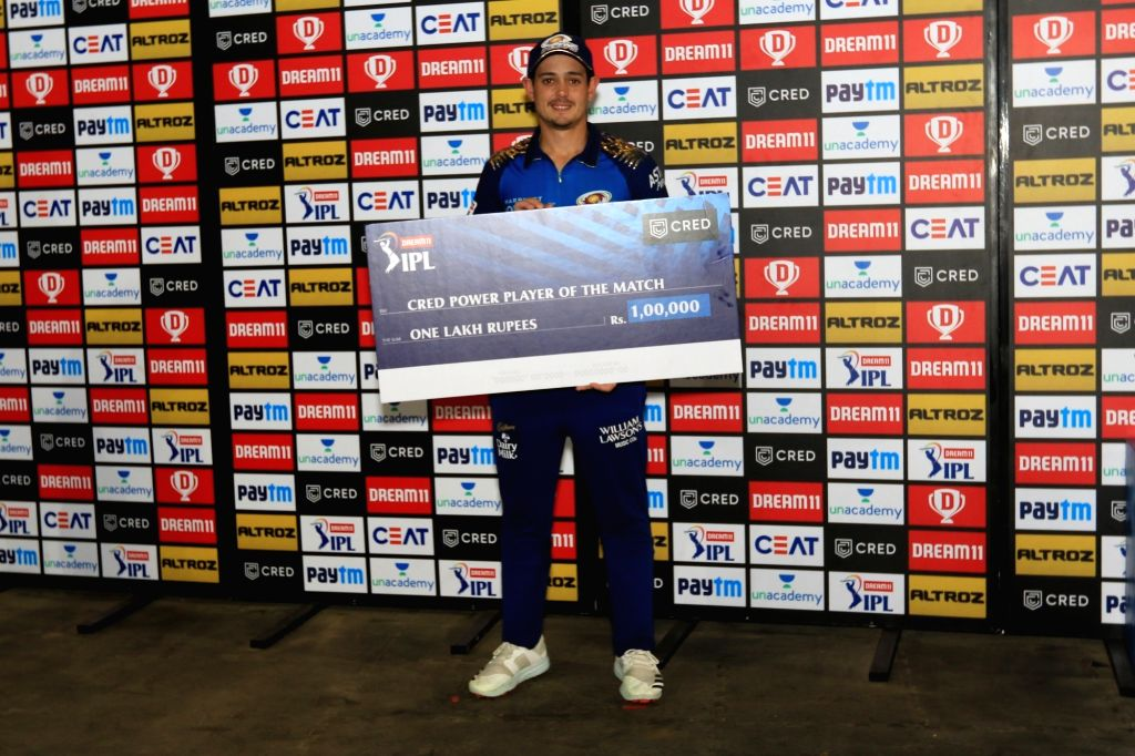 Abu Dhabi: Quinton de Kock of Mumbai Indians receives cred power player award of the match during match 1 of season 13 Dream 11 of Indian Premier League (IPL) held at the Sheikh Zayed Stadium, Abu ...