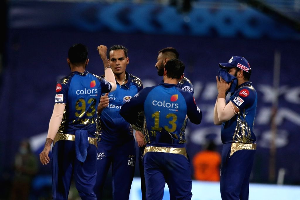 Abu Dhabi: Rahul Chahar of Mumbai Indians celebrates the wicket of Dinesh Karthik captain of Kolkata Knight Riders during match 5 of season 13 of Indian Premier League (IPL) between the Kolkata ...