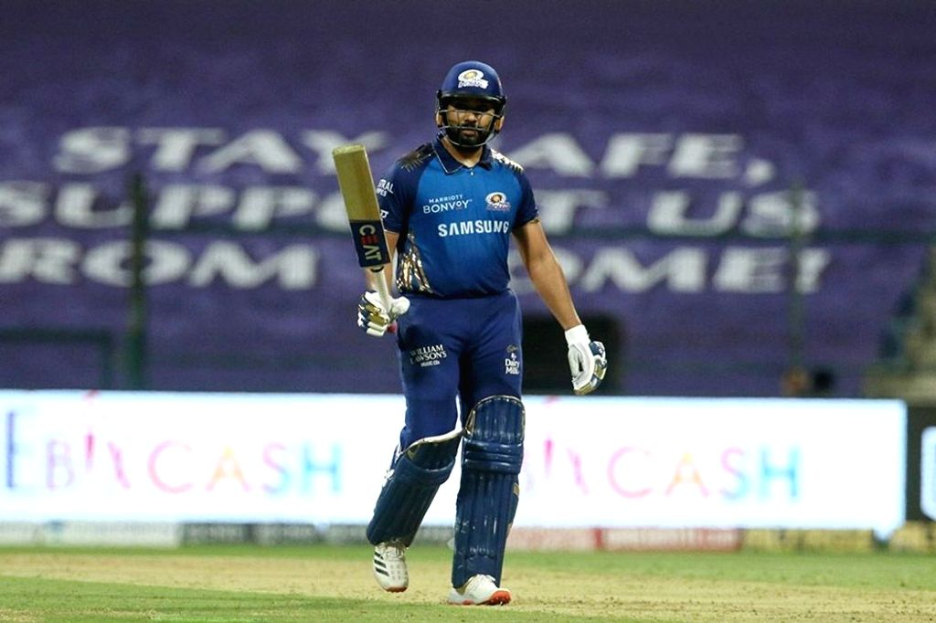 Abu Dhabi: Rohit Sharma captain of Mumbai Indians raises his bat after scoring a fifty during match 13 of season 13 of the Indian Premier League (IPL) between the Kings XI Punjab and the Mumbai Indians at the Sheikh Zayed Stadium, Abu Dhabi in the Un - Rohit Sharma