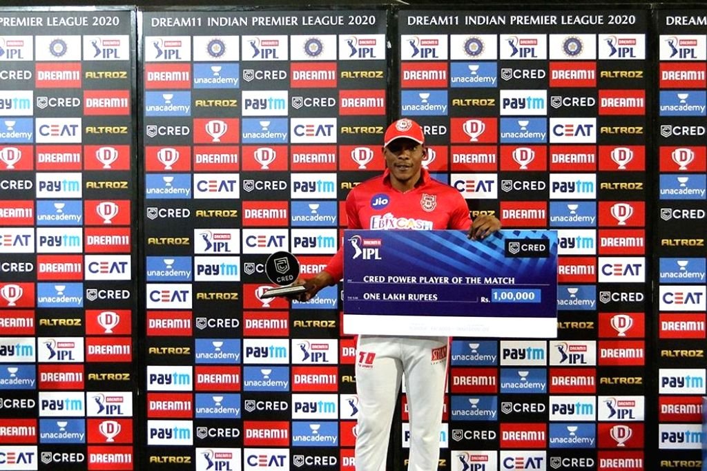 Abu Dhabi: Sheldon Cottrell of Kings XI Punjab receives CRED Power player of the match during the presentation of the match 13 of season 13 of the Indian Premier League (IPL) between the Kings XI ...