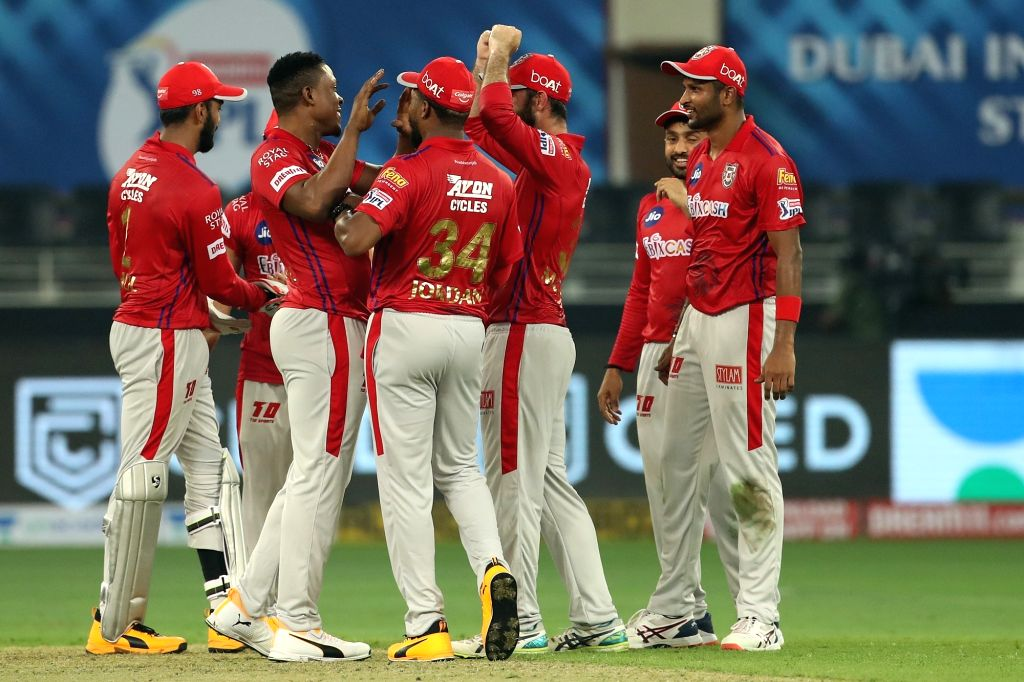 Abu Dhabi: Sheldon Cottrell of Kings XI Punjab and The Kings XI Punjab celebrate the wicket of Axar Patel of Delhi Capitals during match 2 of season 13 of Dream 11 Indian Premier League (IPL) between ... - Axar Patel