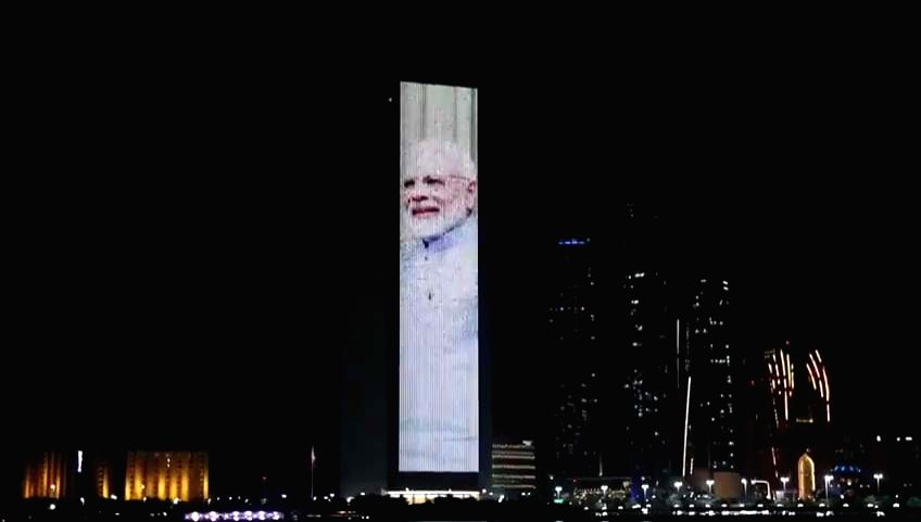 Abu Dhabi: The facade of the ADNOC Group Tower in Abu Dhabi was lit up with the flags of India and the UAE and portraits of Prime Minister Narendra Modi and Abu Dhabi Crown Prince Mohammed bin Zayed ... - Narendra Modi