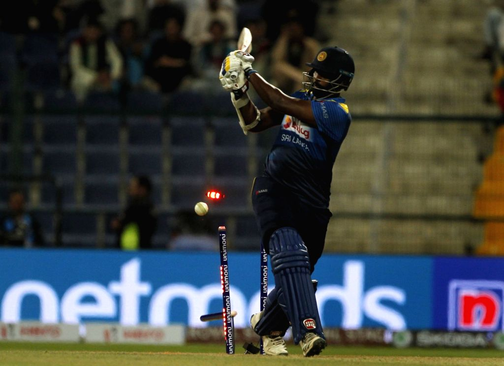 Abu Dhabi: Thisara Perera of Sri Lanka bowled out by Afghanistan's Gulbadin Naib during the third match (Group B) of Asia Cup 2018 between Sri Lanka and Afghanistan at Sheikh Zayed Stadium, in Abu ...