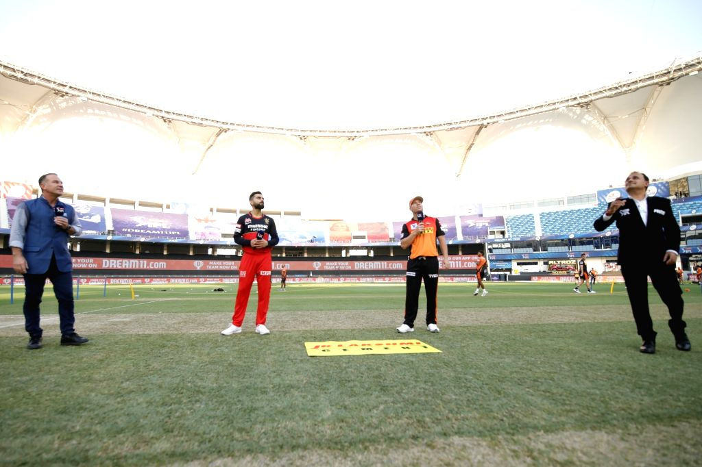 Abu Dhabi: Toss during match 3 of season 13 Dream 11 Indian Premier League (IPL) between Sunrisers Hyderabad and Royal Challengers Bangalore held at the Dubai International Cricket Stadium, Dubai in ...