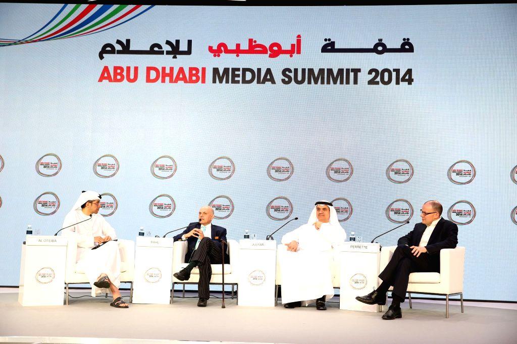 Abu Dhabi (UAE): Participants discuss at the three-day Abu Dhabi media summit in Abu Dhabi, United Arab Emirates, Nov. 18, 2014. Queen Rania Abdullah of Jordan delivered a keynote speech here on ...