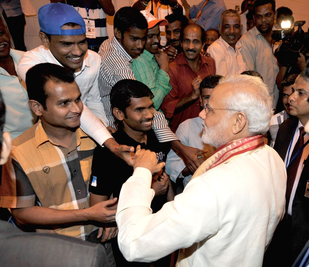 Abu Dhabi (UAE): Prime Minister Narendra Modi interacts with the Indian workers at the ICAD residential city, in Abu Dhabi, UAE on Aug 16, 2015. - Narendra Modi