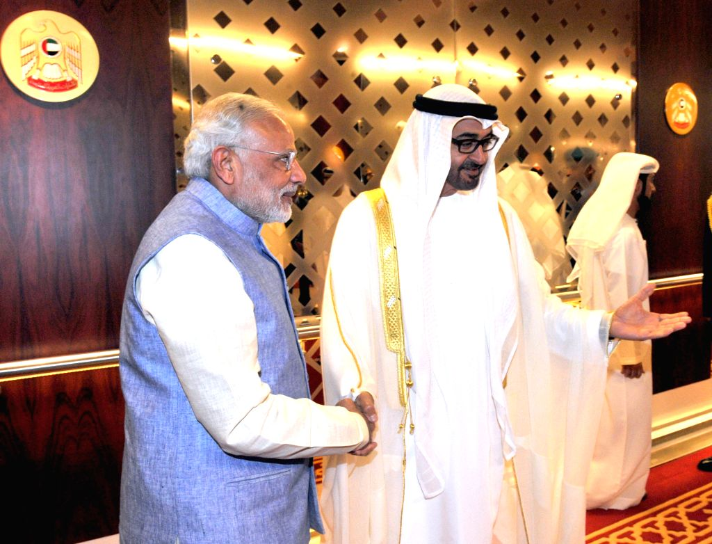 Abu Dhabi (United Arab Emirates): Prime Minister Narendra Modi being received by the Crown Prince of Abu Dhabi, His Highness Sheikh Mohammed bin Zayed Al Nahyan, on his arrival at Abu Dhabi Airport, ... - Narendra Modi and Highness Sheikh Mohammed