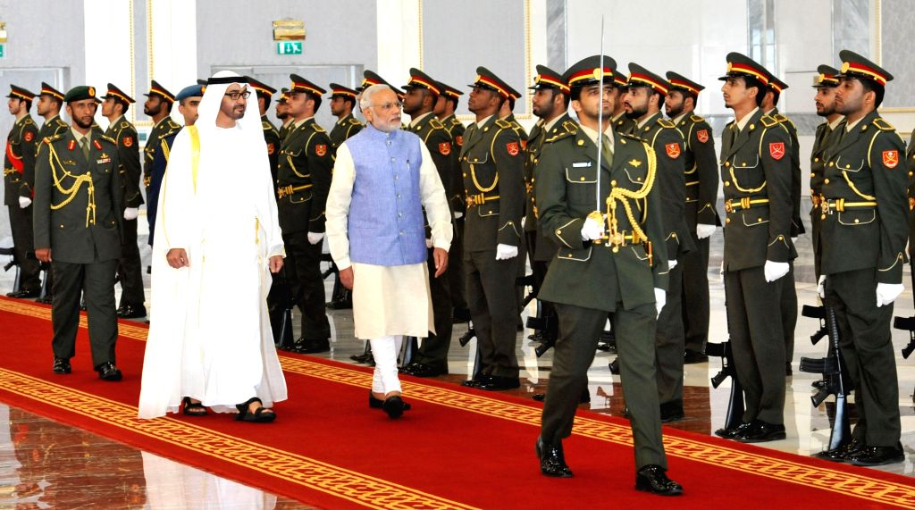Abu Dhabi (United Arab Emirates): Prime Minister Narendra Modi inspects the Guard of Honour at Abu Dhabi, UAE on August 16, 2015. The Crown Prince of Abu Dhabi, His Highness Sheikh Mohammed bin Zayed ... - Narendra Modi and Highness Sheikh Mohammed