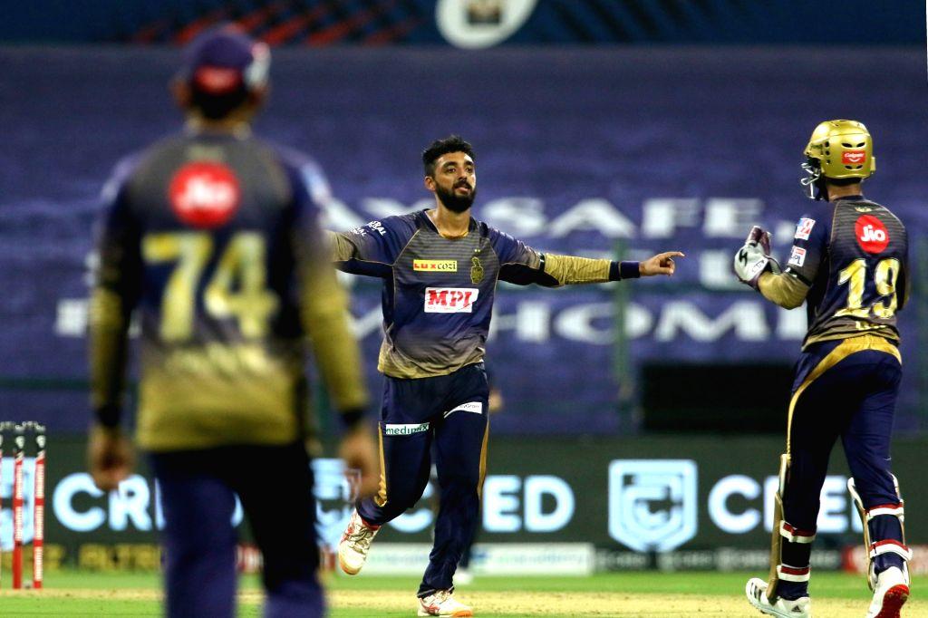 Abu Dhabi: Varun Chakaravarthy of Kolkata Knight Riders celebrates the wicket of David Warner captain of Sunrisers Hyderabad during match 8 of season 13 of the Dream 11 Indian Premier League (IPL) ...