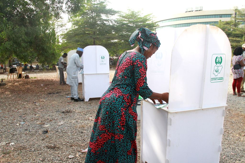 ABUJA, Feb. 23, 2019 - A voter fills her ballot paper at a polling station during the presidential and National Assembly Elections in Abuja, capital of Nigeria, Feb. 23, 2019. More than 72 million ...