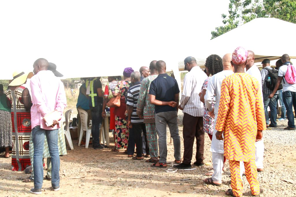 ABUJA, Feb. 23, 2019 - Voters queue up to get accredited before casting their votes at a polling station during the presidential and National Assembly Elections in Abuja, capital of Nigeria, Feb. 23, ...