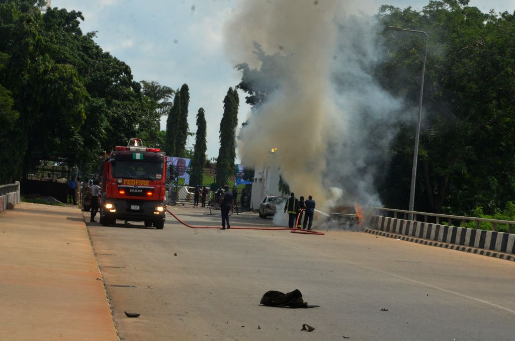 ABUJA, July 9, 2019 (Xinhua) -- Firefighters put out fire on a car after a protest in Abuja, Nigeria, on July 9, 2019. Police authorities in Nigeria said 40 protesters were nabbed on Tuesday after an invasion of the national parliament by members of
