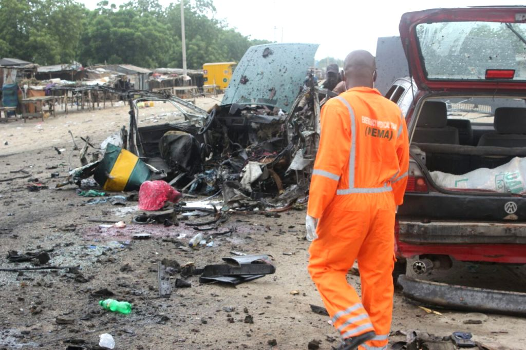 ABUJA, Oct. 12, 2016 - Photo provided by Nigeria's National Emergency Management Agency (NEMA) shows the explosion site near a local motor park in Maiduguri, northeastern Nigeria, on Oct. 12, 2016. ...