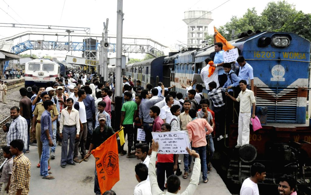 ABVP activists and civil service aspirants demonstrate at Rajendranagar Railway station to press for scrapping of Civil Services Aptitude Test (CSAT) in Patna on July 28, 2014.