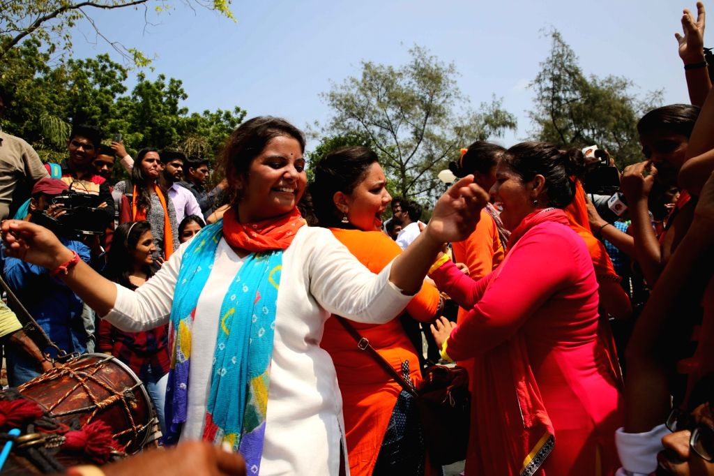 ABVP activists celebrate after ABVP candidates won three out of four posts in DUSU in New Delhi, on Sept 10, 2016.