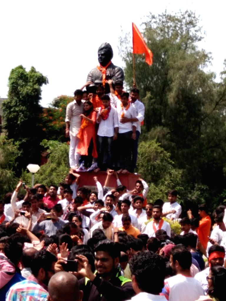 ABVP activists celebrate after winning DUSU election in New Delhi, on Sept 10, 2016.