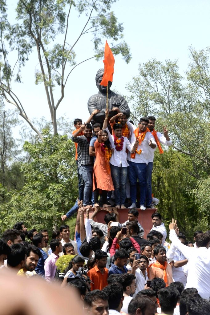 ABVP activists celebrate after winning three out of four DUSU election in New Delhi, on Sept 10, 2016.