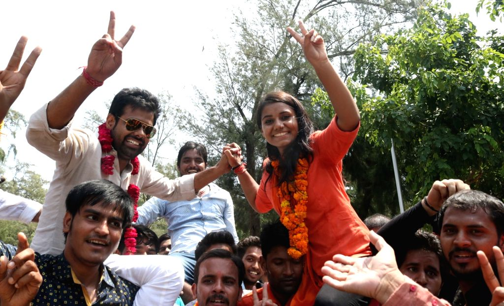 ABVP activists celebrate after winning three out of four posts in DUSU in New Delhi, on Sept 10, 2016.